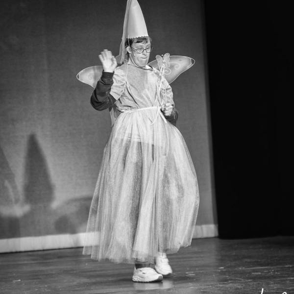 male in skirt with wand in special needs theatre